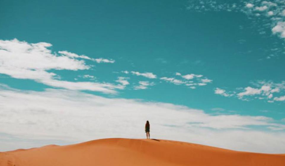 girl on sand dune